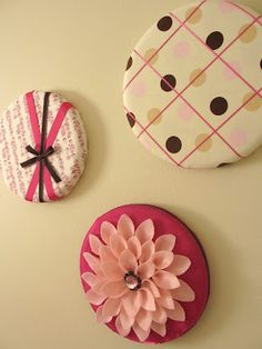These are fabric covered lids (from hat boxes)! So simple and cute! Lots of other ideas at the link too :)