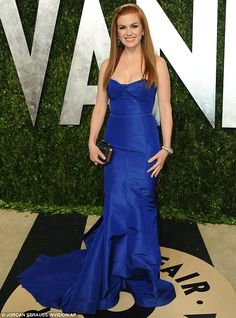 Blue beauty: Isla Fisher looked beautiful in her blue strapless gown with fishtail train