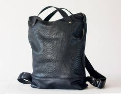 Hey, I found this really awesome Etsy listing at https://www.etsy.com/listing/498336620/backpack-in-black-leather-with-snakeskin