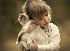 So sweet! Little girl holding her kitty friend close - Photo *** by Elena Shumilova on 500px