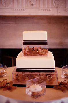 simple wedding cake with gorgeous orchids