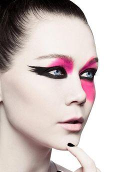 Bold black and pink make up color blocks against dazzling blue eyes