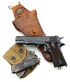 Colt Model of 1911 serial number 137309 (left side) pictured with two Type I magazines, magazine pouch and holster. - I believe this weapon saved civilization. Colt M1911, Colt 45, M1911 Pistol, Revolvers, Military Weapons, Weapons Guns, Guns And Ammo, Fire Powers, Cool Guns