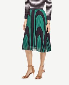 """Adorned with rich waves of color, our pleated chiffon skirt is a standout of the season. Elastic grosgrain waistband. Hidden back zipper with hook-and-eye closure. Lined. 29"""" skirt length; 27"""" lining length."""