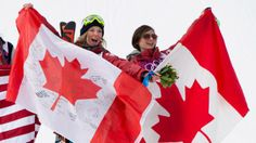 Gold medallist, Dara Howell, left, and bronze medallist, Kim Lamarre celebrate their wins in the ladies' ski slopestyle final at the Sochi Winter Olympics in Krasnaya Polyana, Russia Tuesday, Feb. 11, 2014. (The Canadian Press/Jonathan Hayward)
