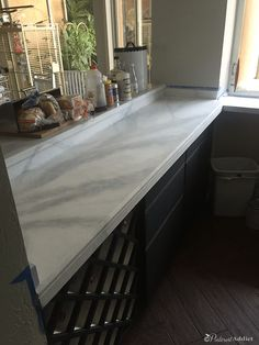 Want to know if you can paint over granite counter tops? I turned my ugly granite into gorgeous faux marble counters with just primer and paint. Painted Granite Countertops, Giani Granite, Granite Paint, Granite Backsplash, Painting Countertops, Cheap Countertops, Kitchen Countertops, Home Bar Areas, Dining Room Office