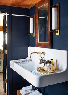 deep blue the farmhouse sink in the guest bathroom is a subtle nod to this charleston homes earlier days as a kitchen house benjamin moores polo blue on