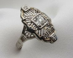Art Deco Diamond Filigree Ring I would want the center stone replaced with an emerald.
