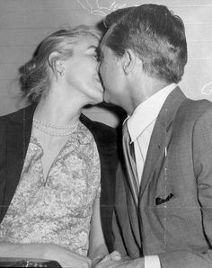 Cary Grant and Betsy Drake share a kiss, c. early 1950s.