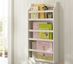 """Hayden Magazine Rack   Pottery Barn Kids $89  17"""" wide x 5"""" deep x 31.75"""" high Expertly crafted of MDF. Keyhole mount; mounting hardware included."""