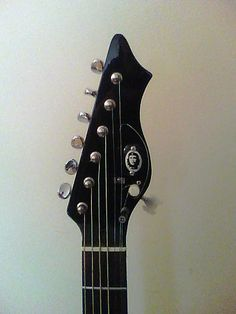 """Guitar headstock for Pim Zond's """"Che"""" Metropolis Guitar by Pim Zond Version 2. High 7th string machine head visible to the right.  2015"""
