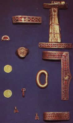 Objects from the burial of Childeric, including gold and garnet cloisonne sword fittings, buckles, coins, and a copy of his signet ring. Bibliotheque Nationale, Paris