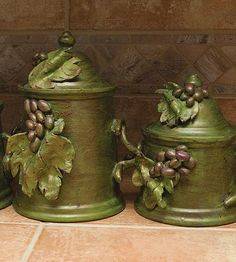 Pfaltzgraff canisters, a wedding gift, get a makeover with paint and clay embellishments to fit in a Tuscan themed kitchen.