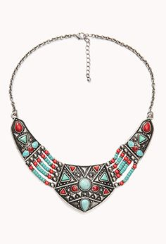 A bib necklace featuring tribal-style beading. Burnished finish. Lobster clasp. Medium weight