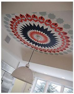 Bright, colorful medallion painted around ceiling light.