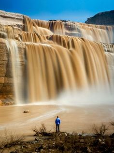 """Grand Falls on the Navajo Nation is also known as the """"Chocolate Falls,"""" and you can see why in this photo from Laurynas Bileisis of Flagstaff. Bileisis says a 10-second exposure and a timer created this smooth self-portrait opportunity. See more photos at instagram.com/lithuanianlo.  Laurynas Bileisis"""