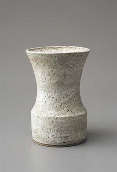 Vase with cylindrical foot, Stoneware, white pitted glaze. The wide cylindrical foot beneath a flaring section with a squeezed oval lip, 9 1/2 in. (24.1 cm) high, c.1972