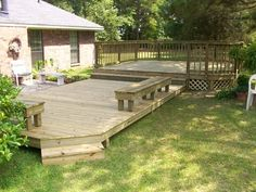 Custom wood deck, multi-level, railing, steps and built in bench