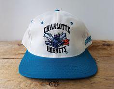 Nba Basketball Teams, Charlotte Hornets, Strapback Hats, Embroidered Hats, Dad Hats, Metal Buckles, Hat Sizes, Skateboarding, Baseball Cap