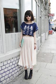 I wish I could carry this look off! Love the skirt and tee shirt styling