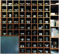 Peter Grigg's collection of 83 vintage cameras. Each camera lives in its own cubby and together they create a more powerful artistic statement. the perfect way to display a collection.