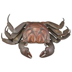 Japanese Bronze Articulated Model of a Crab Meiji Period Cast realistically with a molded carapace, constructed of numerous parts joined together, with movable pincers and four legs, the shell and body with incised detailing. Length 7 inches.