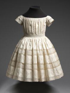 Philadelphia Museum of Art - Collections Object : Child's Dress Mid- 19th century Medium:Cotton plain weave, cotton/linen plain weave reverse appliqué, cotton lace