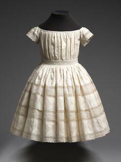 Via Philadelphia Museum of Art -  Child's Dress Mid-19th century. Cotton plain weave, cotton/linen plain weave reverse appliqué, and cotton lace.