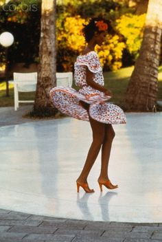 Action shot of model Iman wearing flounce skirt and offtheshoulder top by Yves Saint Laurent with red three inch mules Saint Laurent Dress, St Laurent, David Bailey, Rive Gauche, French Fashion Designers, Travel Alone, Supermodels, Saints, Vogue