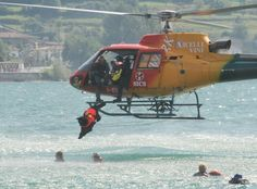 A water rescue newfoundlander jumps off a helicopter (training in Italy, not a rescue situation)