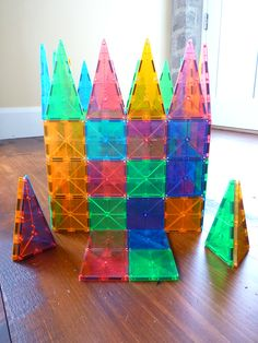 Magna-Tiles: Colorful shapes with imbedded magnets. So pretty! via chinesegrandma #Toy #Construction #magnatiles