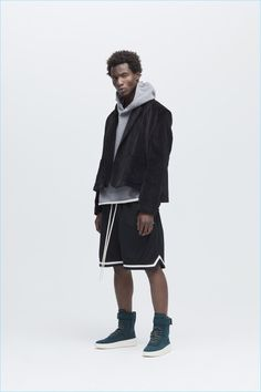 Adonis Bosso wears a cropped jacket with a hoodie, shorts and hi-top sneakers from Fear of God's fall-winter 2017 collection.