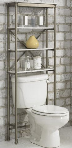 In small bathrooms, an over-the-toilet shelving system is a must. This one's faux marble, open shelves add a touch of luxury, while keeping the bathroom feeling open and airy.