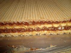 1 pachet foi Lica Crema 1 250g zahar + 7 galbenusuri + 2 plicuri zahar vanilat se fierb pe aburi, apoi se racesc; se adauga o j...