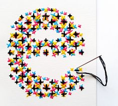 Embroidered CMYK Typography by Evelin Kasikov