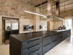 dark contrast with the light stone walls #nuspacelondon #design #kitcheninspiration