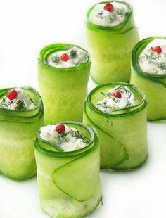 use thin slices of cucumber as cups for creamy cheese and other food decorations. Very elegant idea!!