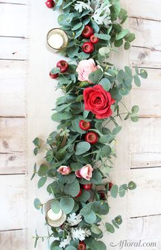 Make your own floral table garland with faux eucalyptus and roses from Afloral.com.