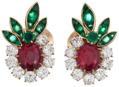 Earrings from: Van Cleef & Arpels Convertible Suite. Museum-worthy Van Cleef & Arpels necklace and earrings suite decorated with flowers made of gemstones: cabochon rubies, brilliant diamonds and intense green emeralds form a garland of lifelike and dazzling flowers. The necklace comes apart and splits into a set of two bracelets. The earrings are accompanied by their original presentation box. Via 1stdibs.