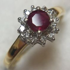 RUBY...This stunning blood red Ruby is set off beautifully by the little diamonds surrounding it ❤️ #milesmannoutlet #ruby #rubyred #diamonds #cluster #18ct #yellowgold #goldjewelry #ring #clusterring #finejewelry #ilovejewelry #accessoryaddict #youneedthis #nofilterneeded #forsale #forher #ebayebay,18ct,ruby,goldjewelry,yellowgold,cluster,ilovejewelry,clusterring,nofilterneeded,milesmannoutlet,finejewelry,rubyred,forsale,diamonds,ring,forher,accessoryaddict,youneedthis