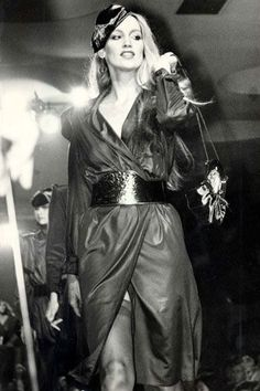 Jerry Hall was renowned for Roxy Music era glamour - think jewel tones, satin, catsuits and disco vibes.