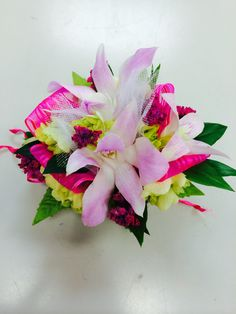 Pink orchid on pink wrist band prom corsage