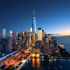 Lower Manhattan at night by DTmet - The Best Photos and Videos of New York City including the Statue of Liberty, Brooklyn Bridge, Central Park, Empire State Building, Chrysler Building and other popular New York places and attractions.