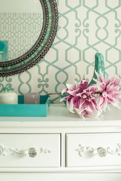 Pairing turquoise with creamy white and pink creates a modern twist on a classic little girl's room palette.