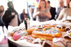 Wedding Doughnuts | Wonderfully Cool Offbeat Portland Wedding At Voodoo Doughnut | Photograph by Megan Love Photography  http://storyboardwedding.com/offbeat-portland-wedding-voodoo-doughnut/
