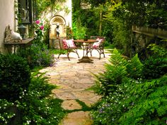 "The Story Of ""Tales From Carmel"". I love how lushly surrounded with greenery this patio is."