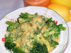 Broccoli With Cheese Sauce from Food.com: made this for a dinner side tonight w/ff milk & lf cheese. Yum! An easy side dish to have with any meal! The cheese sauce makes this the ultimate vegetable. It also makes your dinner plate colorful and pretty! Quick preparation.