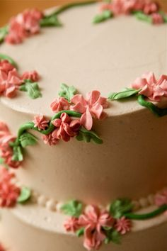 Cake by @Baked NYC Brooklyn---I love idea of using different star and flower tips to make flowers on the same cake. I also like the trailing vine look (especially because this is, I believe, a tiered cake.)
