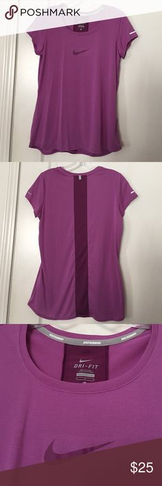 Women's Nike dri fit tee Magenta EUC tee in size medium.   rn#56323 and made of 100% polyester.  It is light weight and super soft for that comfortable exercise or lounge wear. Nike Tops Tees - Short Sleeve