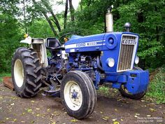Ford tractor...may not be new and it might be painted blue but Deere doesn't have a clue what this ford tractor can do.